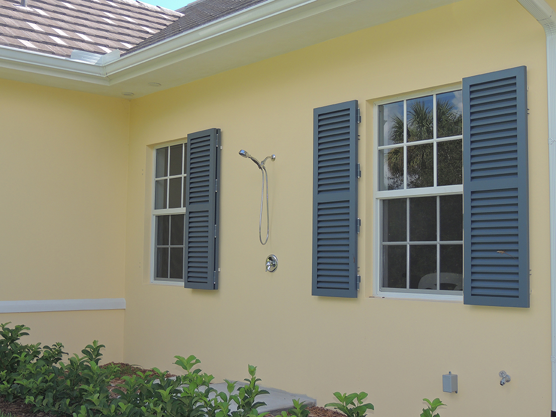 Arched Colonial Hurricane Palm Coast Shutters